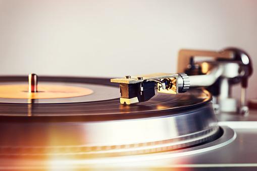 Hifi retro vinyl player is turntable with an analog audio CD.