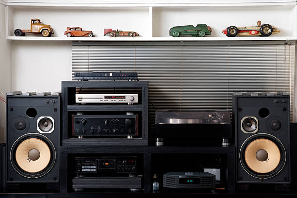 Hi-Fi sound system with vintage tin toy car The room of the hobby, Hi-Fi sound system with vintage tin toy car.  stereo stock pictures, royalty-free photos & images