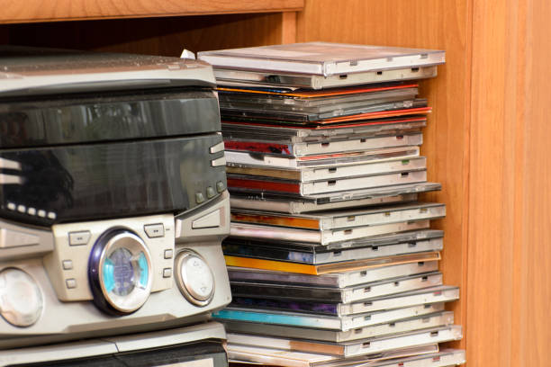 A HiFi tower with a collection of music on CD and DVD.