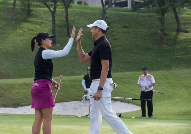 High 5 after that great golf shot stock photo