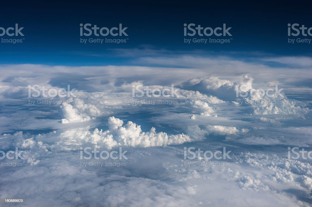 High above the clouds - view out of an airplane stock photo