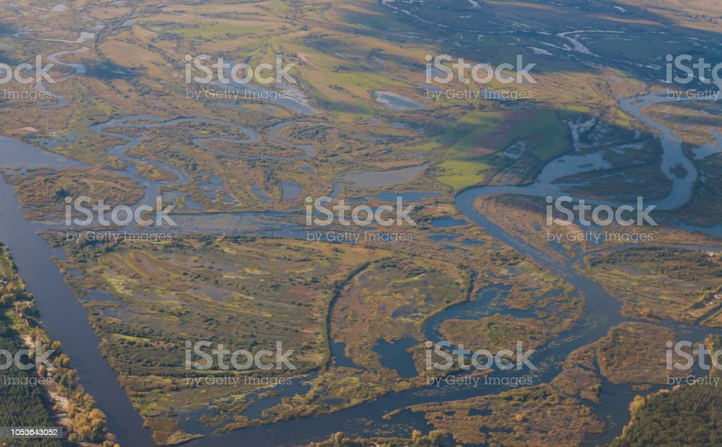 High above the ground view from airplane earth from height stock photo
