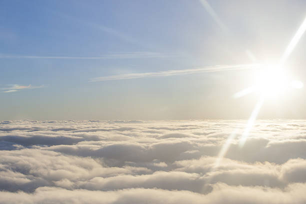 high above the sun and clouds stock photo