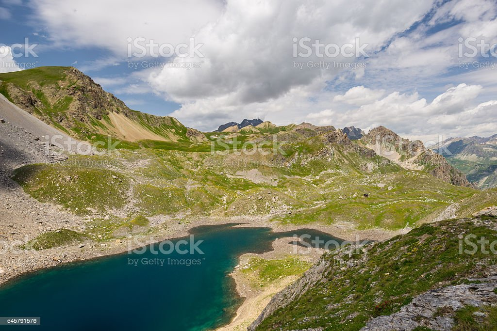 High altitude blue lake, summertime on the Alps stock photo
