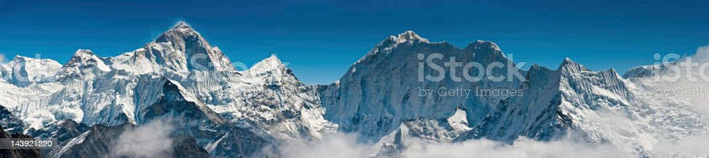 The iconic summit pyramid of Makalu towering over the snow fluted...