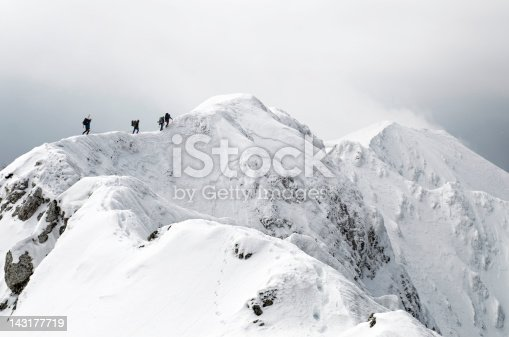 team of alpinism on the ridge of a mountain