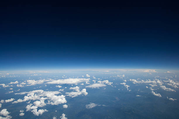 high altitude view of slight curvature to the earth... - stratosphere stock pictures, royalty-free photos & images