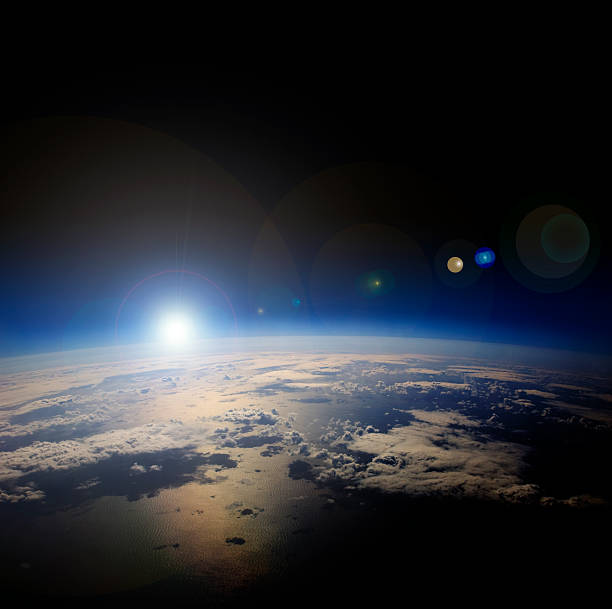 high altitude view of sunrise over earth. - stratosphere stock pictures, royalty-free photos & images