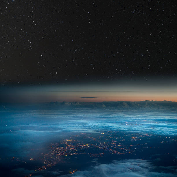 high altitude view of the earth at night. - stratosphere stock pictures, royalty-free photos & images