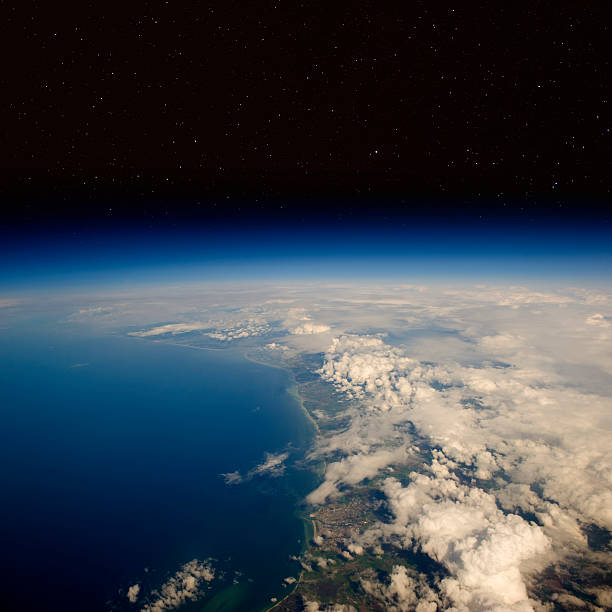 high altitude view of the earth in space. - stratosphere stock pictures, royalty-free photos & images