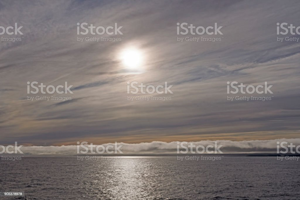 High and Low Clouds on the Ocean stock photo