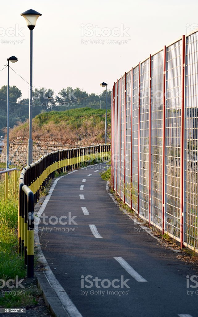 high and low railing on the cycling track stock photo