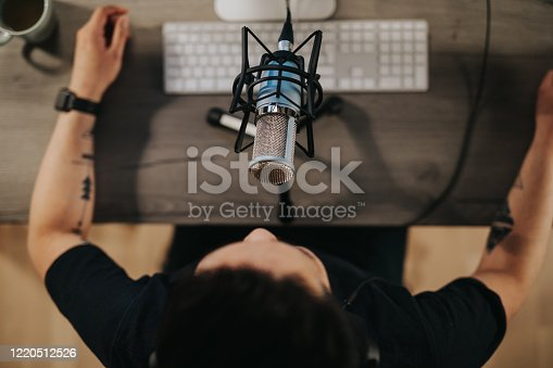 istock High angel view of a podcaster behind microphone 1220512526
