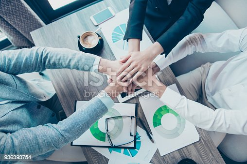 istock High angle cropped view of colleagues putting their hands on top of each other, wearing formal outfits. Concept of successful teambuilding and unity, onness 936393754