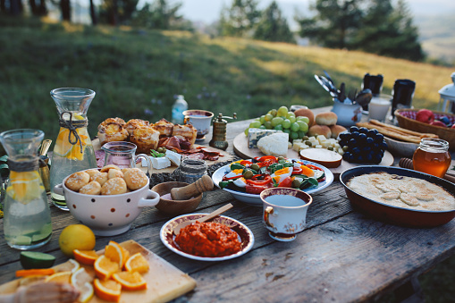 Food for picnic day in the countryside. Various foods on an old, rustic, wooden table.