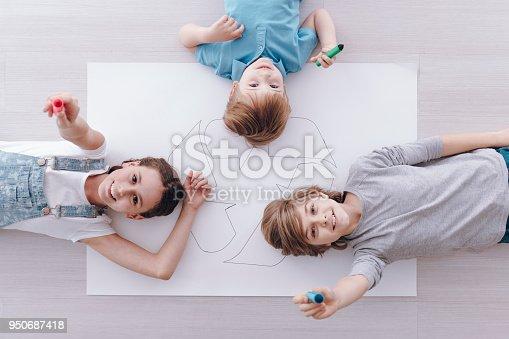 istock High angle of smiling kids 950687418