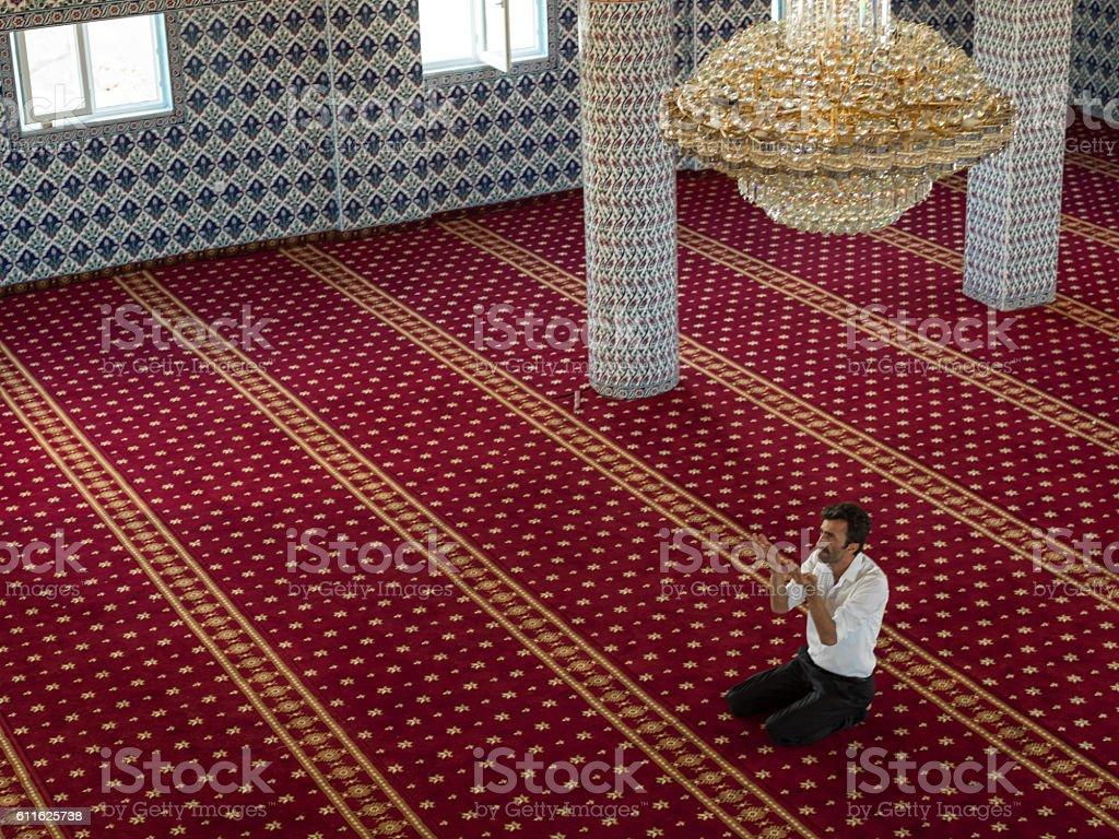 High Angle Portrait Of Muslim Man Praying Mosque stock photo
