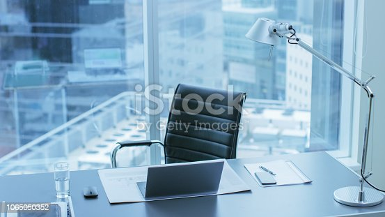 High Angle Shot of a Working Desk of an Successful Person in Office with Cityscape Window View.