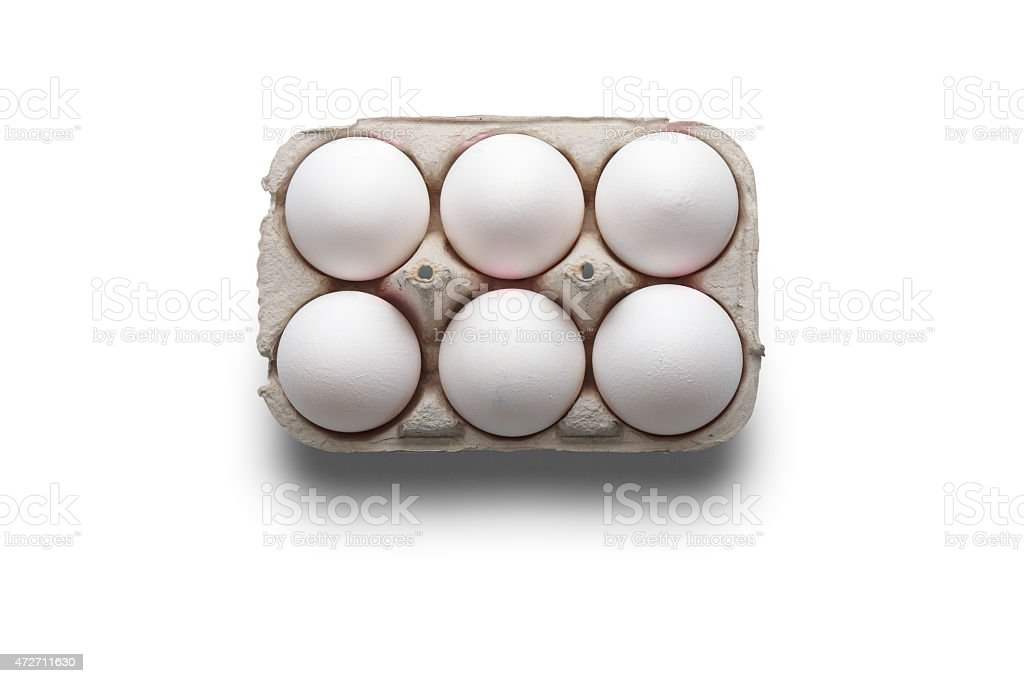 High angle studio shot of six white eggs in box stock photo
