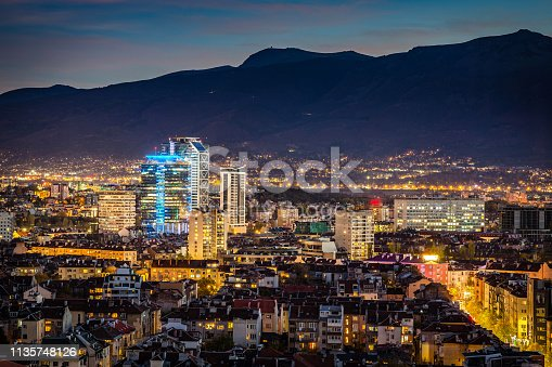 Panoramic high angle view above Southern part of city of Sofia, Bulgaria, Eastern Europe during the blue hour and the downtown night illumination, including: Vitosha mountain and the highest peak of Cherni Vrah as a background. Shot on Canon EOS full frame system with prime lens.