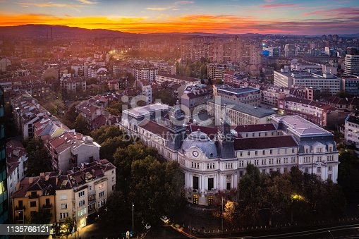 Panoramic high angle view above Western city of Sofia, Bulgaria, Eastern Europe during sunset back light into the sky. Shot on Canon EOS full frame system with tilt-shift prime lens.