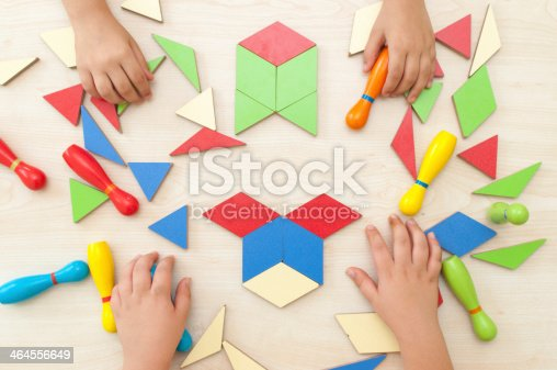 istock High angle view of a boys playing tangram puzzle 464556649
