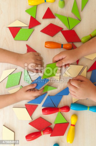 istock High angle view of a boys playing tangram puzzle 475684813