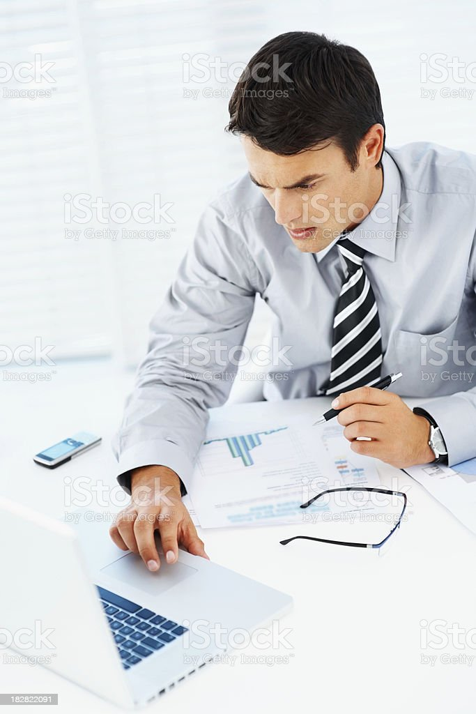 High angle view of a businessman using laptop royalty-free stock photo