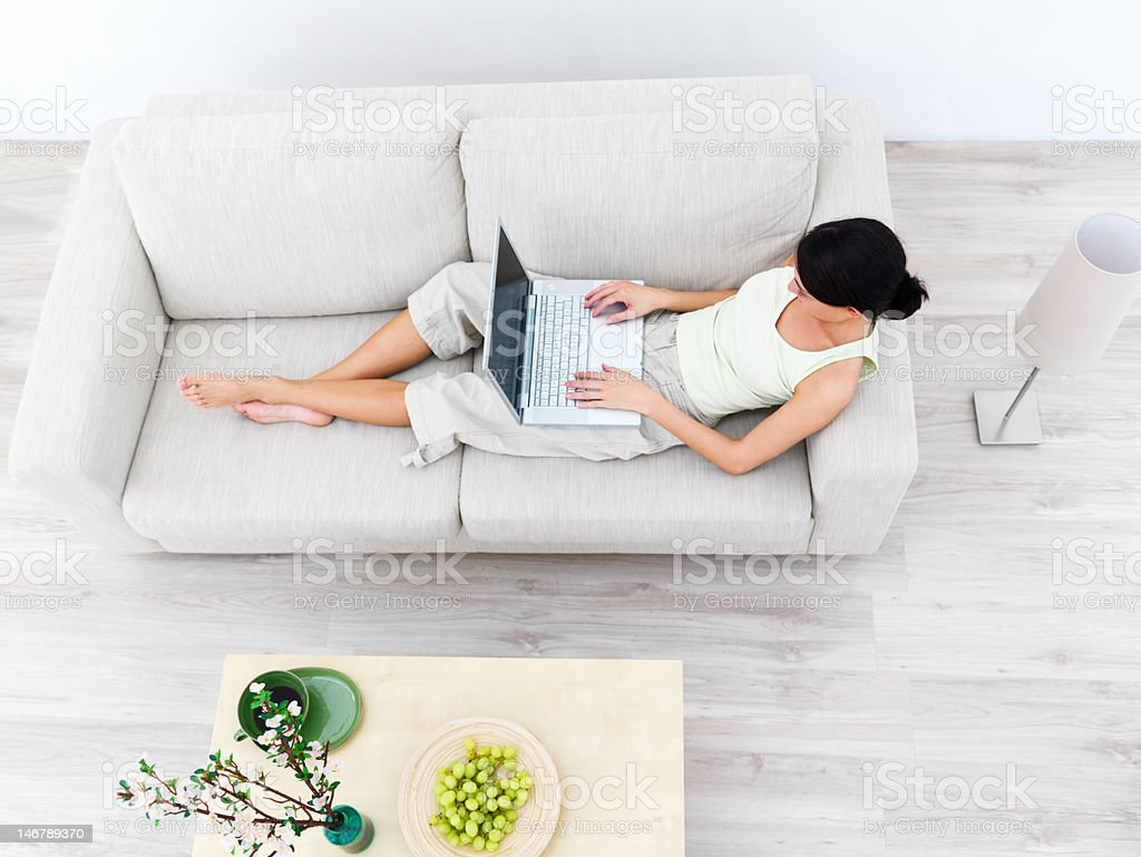 High angle view of a businesswoman using laptop on sofa royalty-free stock photo