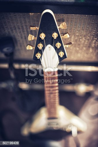 High angle view of a guitar leaning on an amp.