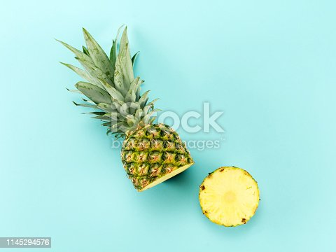 High angle view of a Halved Pineapple on blue background