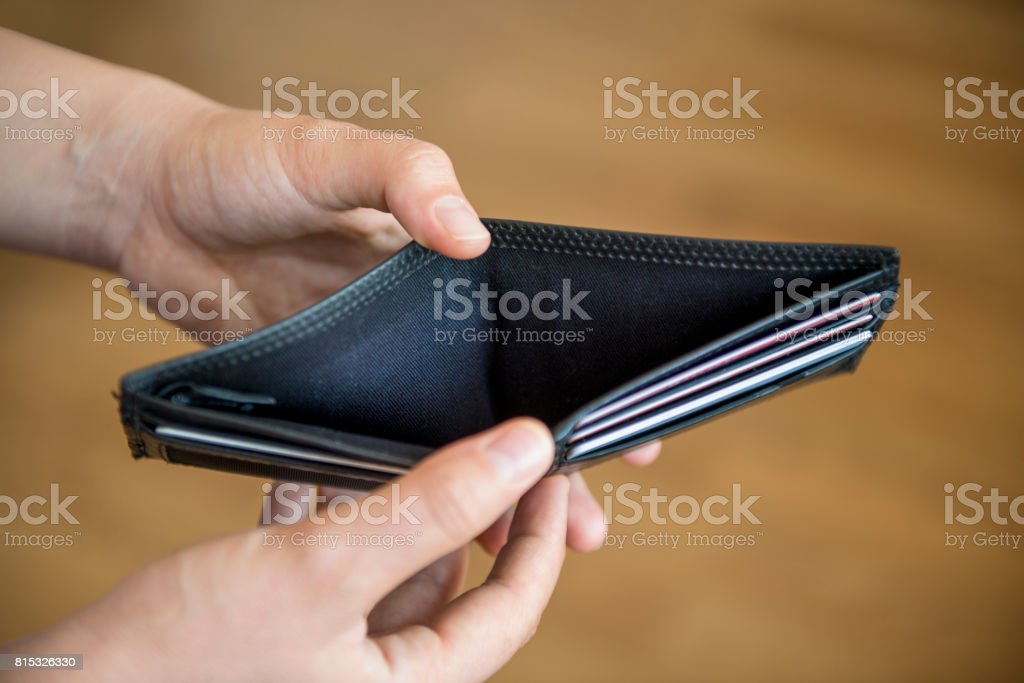 High angle view of a man showing his empty wallet stock photo