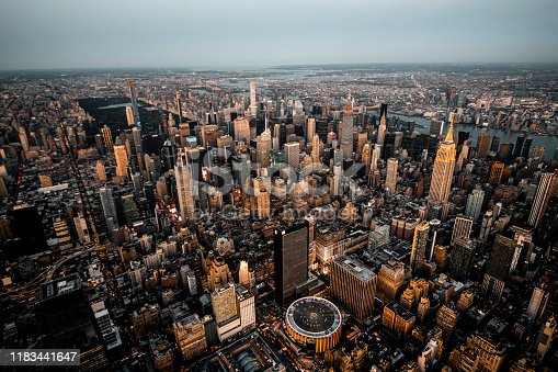 Helicopter view of a Midtown Manhattan city skyline taken at golden hour.