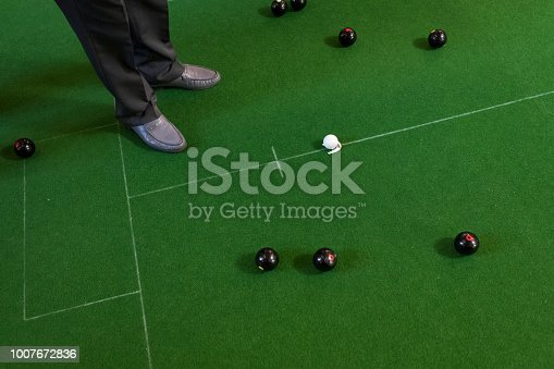 High angle view of a man's feet and bowling balls