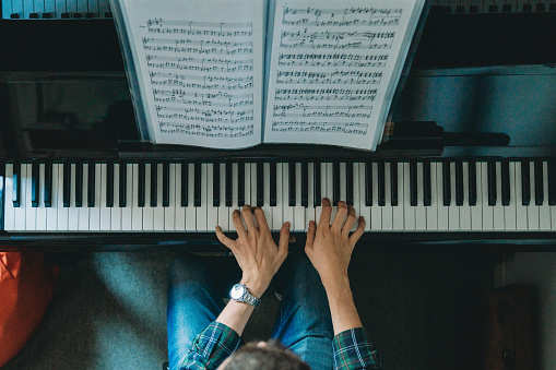 High angle view of a pianist playing piano