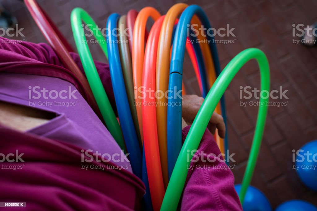 High angle view of a senior woman holding a plastic hoop stock photo