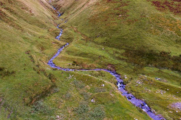 High angle view of a small stream in remote rural south west Scotland stock photo