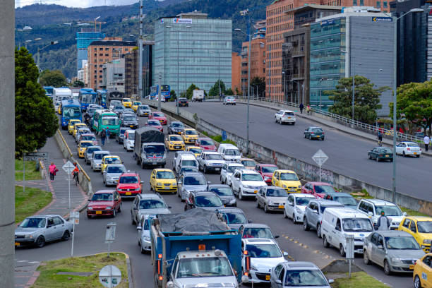 High Angle View Of A Trancon Or Bumper To Bumper Traffic Jam On The Westbound Carriageway Of The Bridge On Calle 100 Over The Autopista Norte In The Colombia Capital City Of Bogota In The La Castellana Area. stock photo