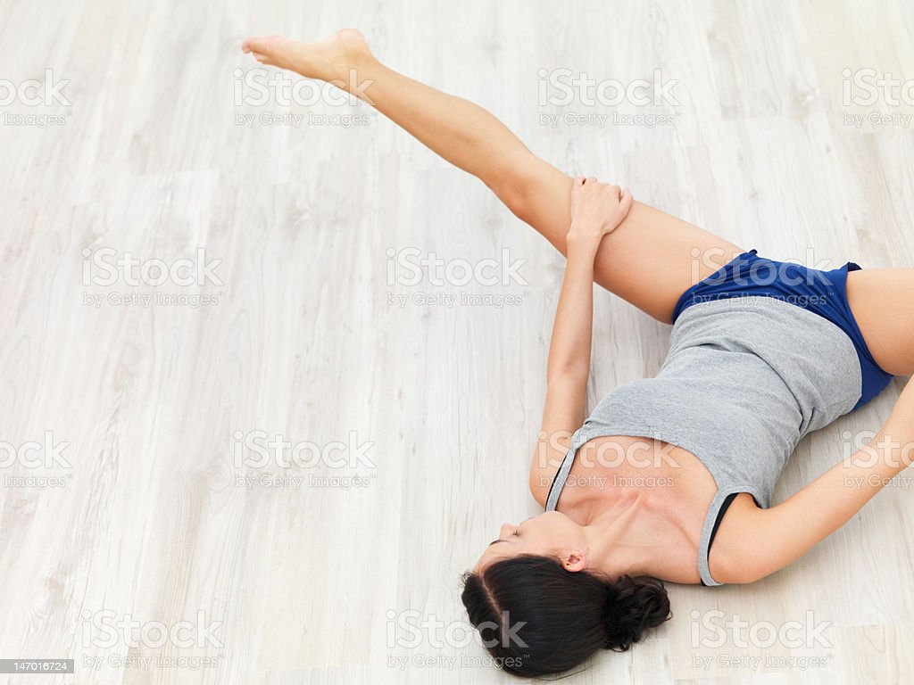High angle view of a young woman exercising stock photo