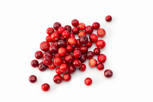 high angle view of arrangement of Cranberries on white - foto de stock