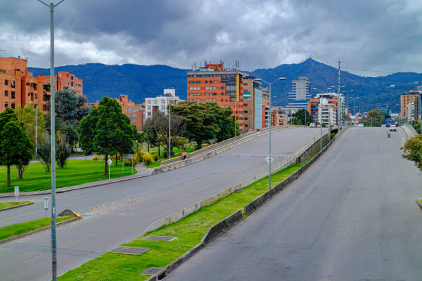 High Angle View Of Bridge On Calle 100 Over The Autopista Norte In The Colombia Capital City Of Bogota In The La Castellana Area. Normally Packed With Heavy Vehicular Traffic, It Is Deserted Due To The Coronavirus Lockdown In The Country stock photo