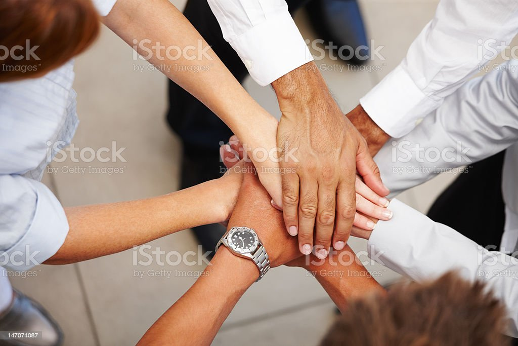 High angle view of business colleagues showing unity stock photo