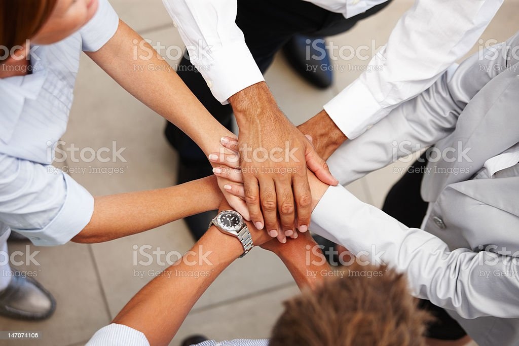 High angle view of business colleagues showing unity High angle view of business colleagues showing unity 20-24 Years Stock Photo