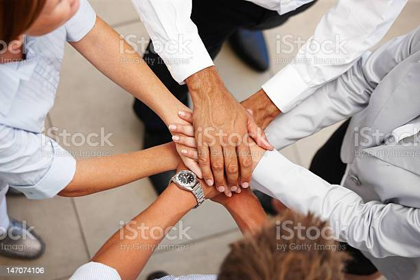 High Angle View Of Business Colleagues Showing Unity Stock Photo - Download Image Now