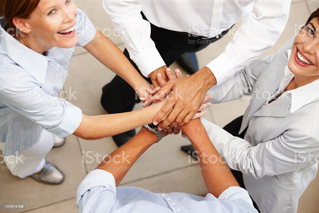 High angle view of business colleagues showing unity royalty-free stock photo