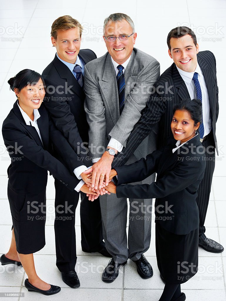 High angle view of business people stacking hands royalty-free stock photo