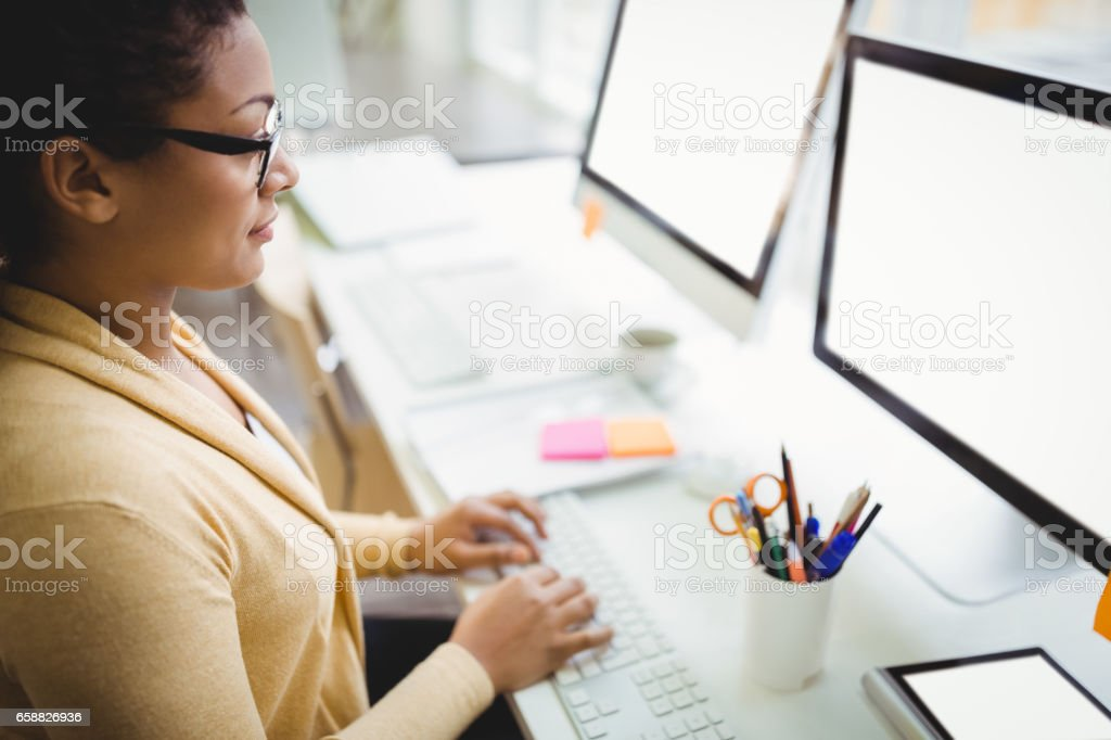 High angle view of businesswoman working in creative office stock photo