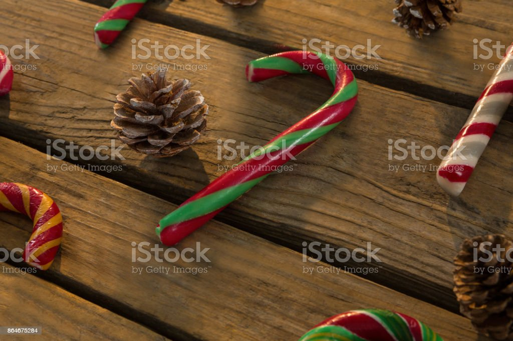 High angle view of candy canes and pine cones on table stock photo