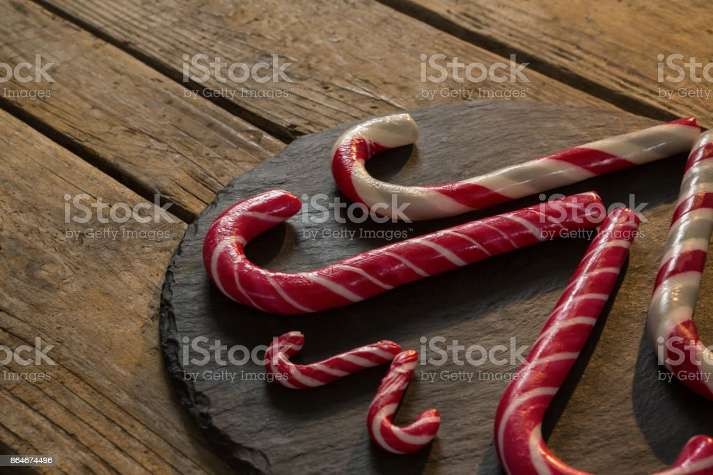High angle view of candy canes on wood stock photo