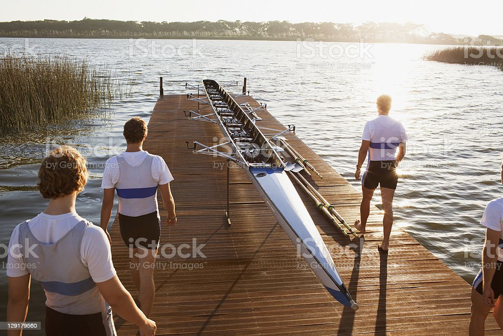High angle view of canoe and people on pier stock photo